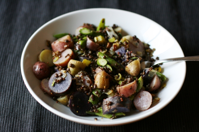 Warm potato salad with lentils, asparagus, and caramelized leeks
