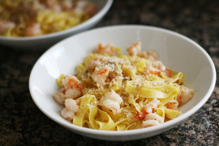 Shrimp pasta with parmesan and ground walnuts
